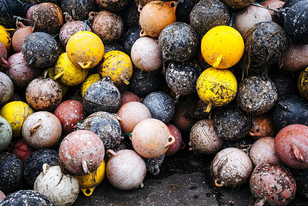 High angle close up of heap of fishing buoys, Japan