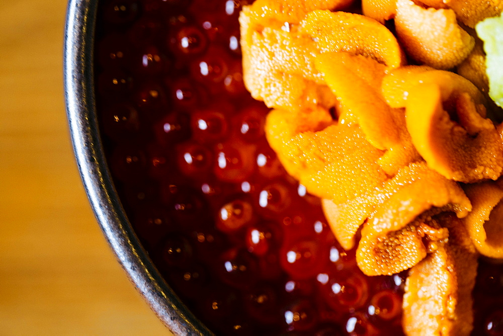 High angle close up of uni, sea urchin, with salmon roe and rice, Japan
