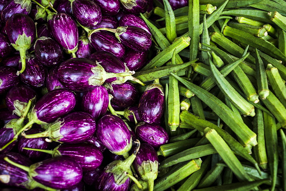 High angle close up of eggplants and okra, Singapore