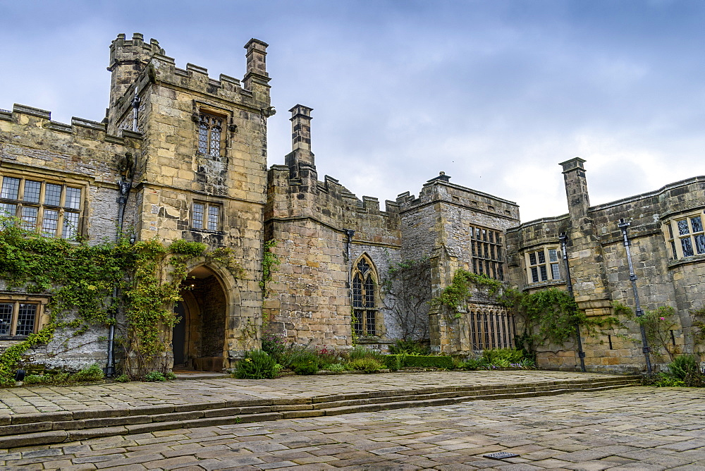 Exterior view of a Tudor fortified house, with a central entrance tower, United Kingdom