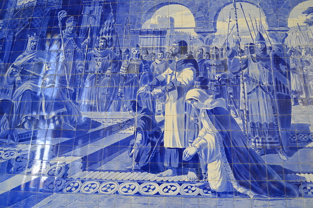 Azulejos blue and white glazed tiles, a close up of a traditional mosaic tiles depicting a historic event. Porto Railway Station, Porto, Portugal