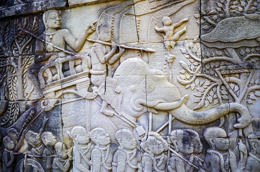 Ankor Wat, a 12th century historic Khmer temple and UNESCO world heritage site. Arches and carved stone bas relief panels with scenes from Khmer cultural history, Angkor Wat, Cambodia