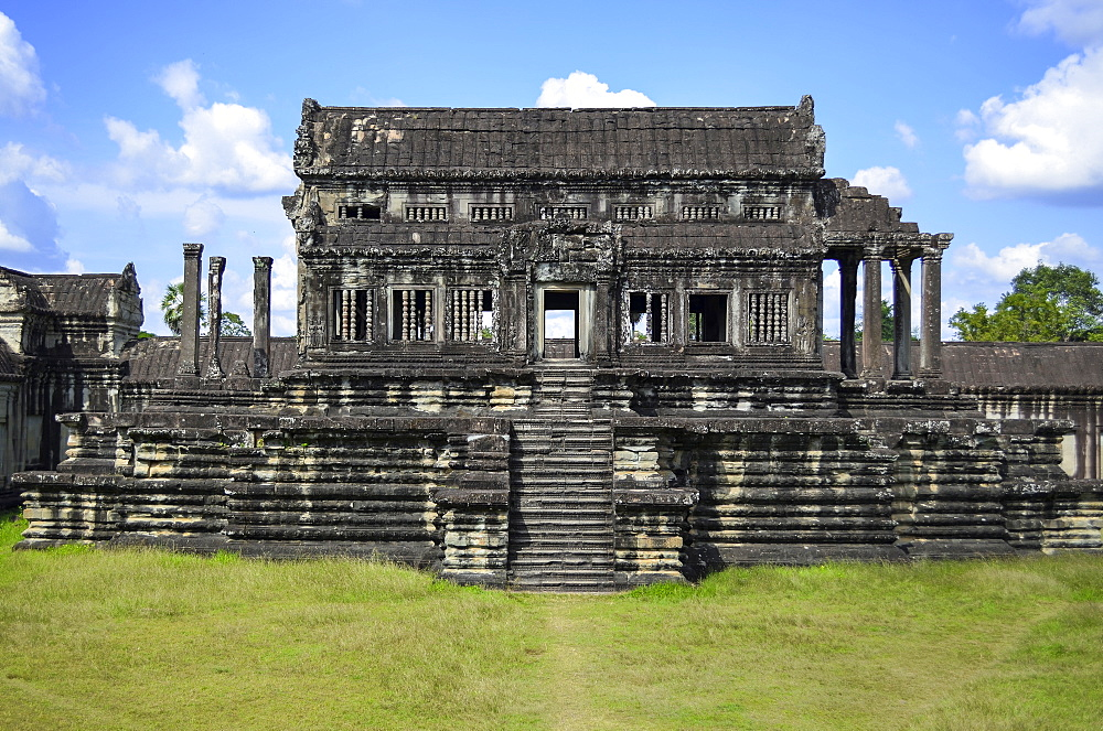 Ankor Wat, a 12th century historic Khmer temple and UNESCO world heritage site. Arches and carved stone temple structures. Archaeological site, Angkor Wat, Cambodia