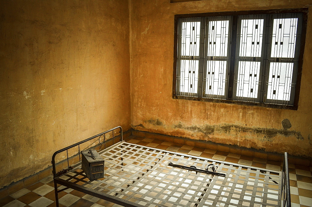 Interior view of prison cell at the Tuol Sleng Genocide Museum, Phnom Penh, Cambodia