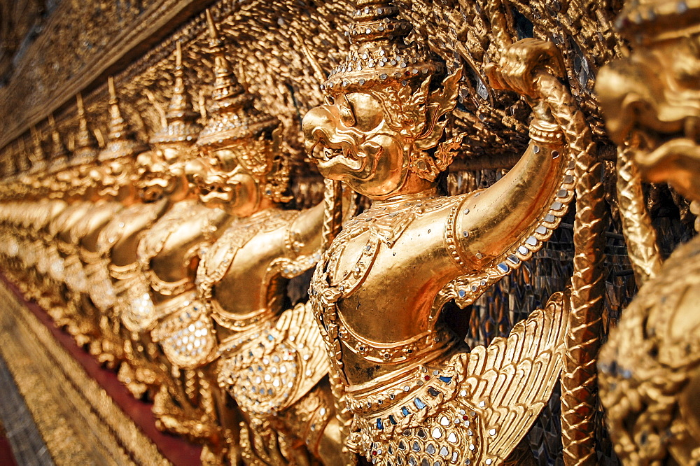 Close up of golden shrine at Wat Pho Buddhist temple complex in Bangkok, Thailand