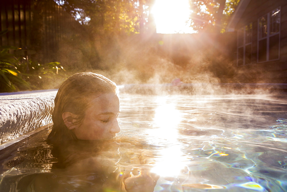 A teenage girl swimming in a pool, St Simon's Island, Georgia, United States
