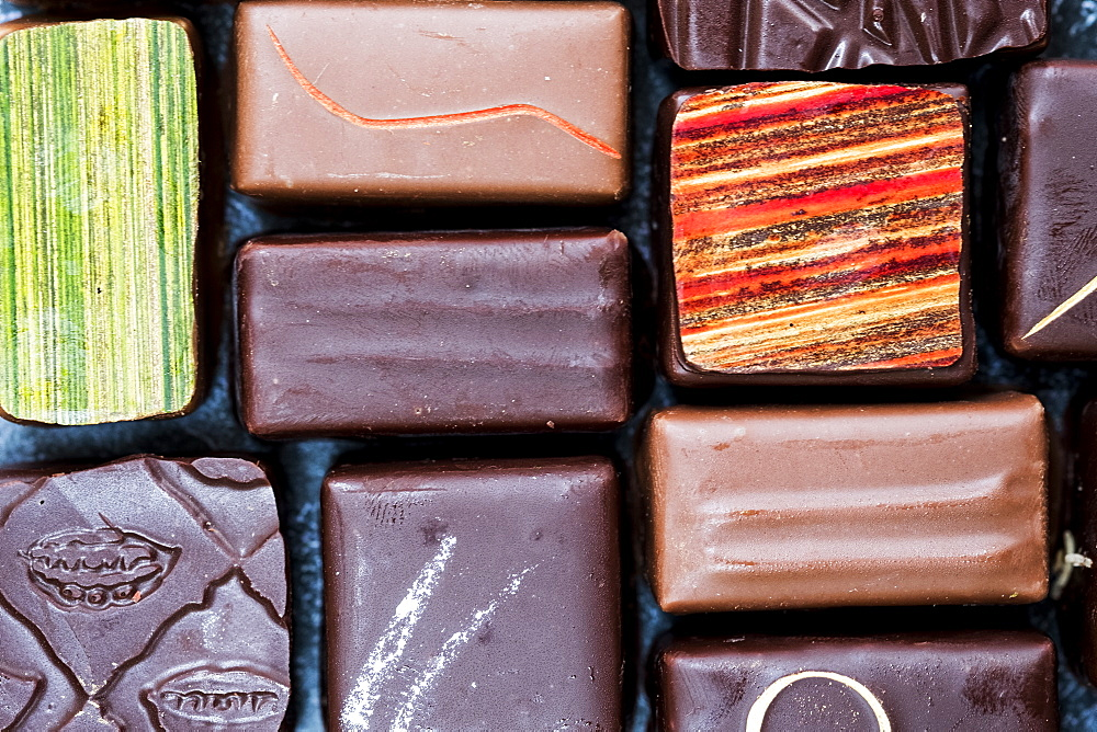 High angle close up of a selection of chocolate pralines, United Kingdom - 1174-7835