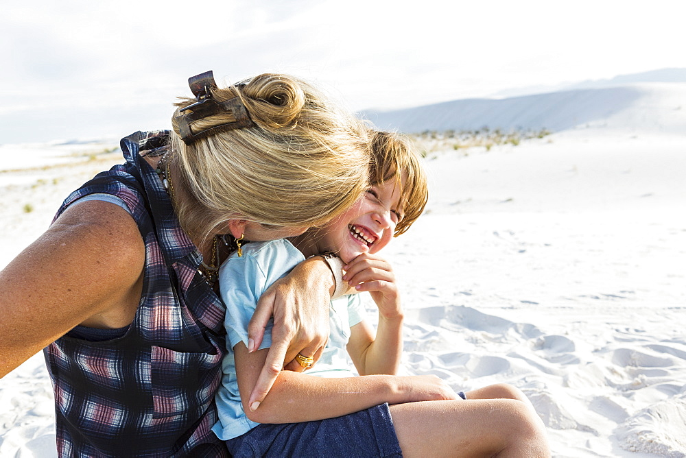 Mother and her six year old son embracing, White Sands National Monument, New Mexico, United States