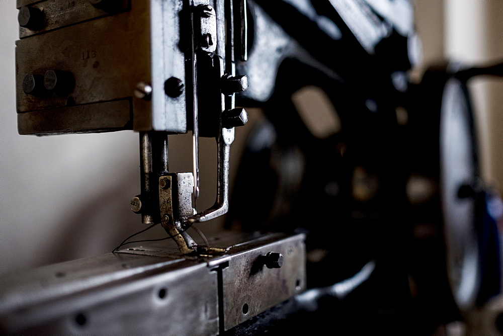 Close up of saddlery sewing machine in a saddler's workshop, Berkshire, United Kingdom