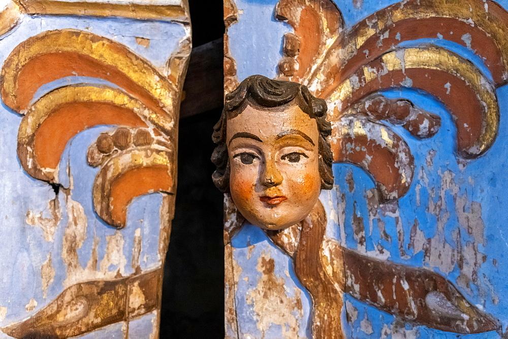 Carved head on wooden door, Tavira, Algarve, Portugal
