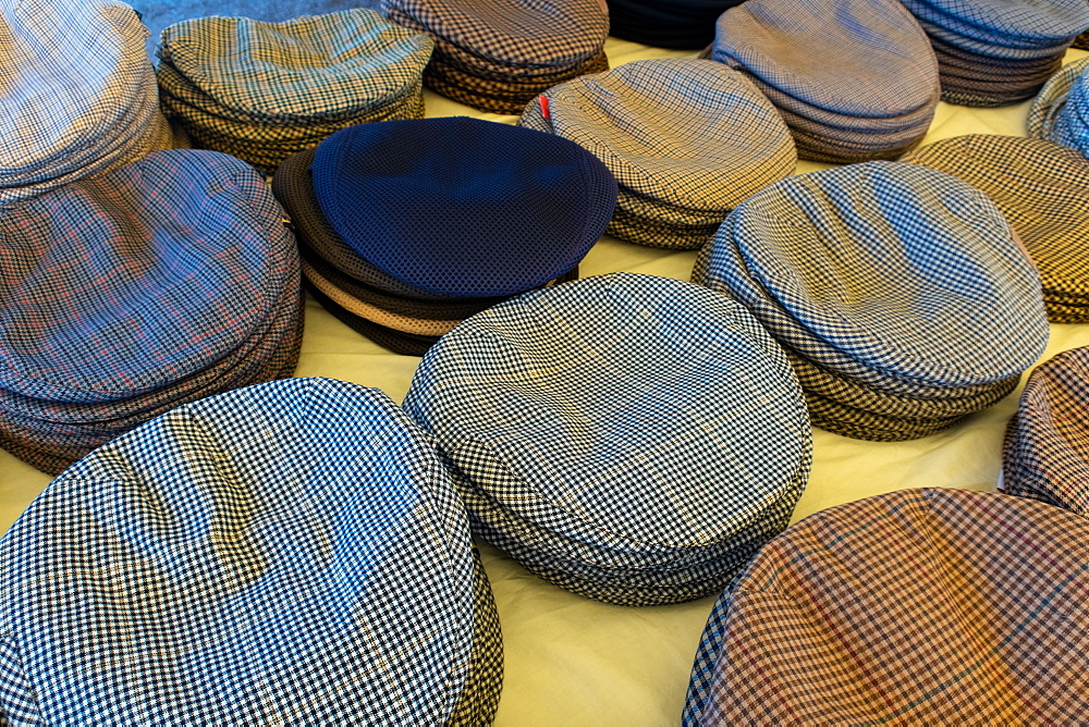 Cloth caps on sale in the Mercado Municipal, the main market in Tavira, Algarve, Portugal