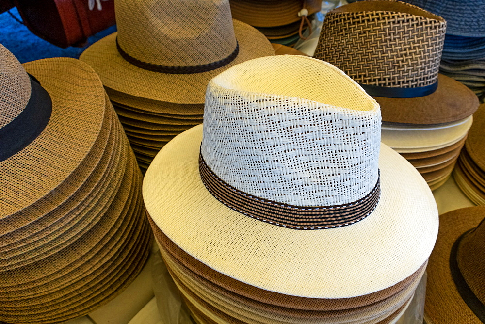 Panama style hats on sale in the Mercado Municipal, the main market in Tavira, Algarve, Portugal