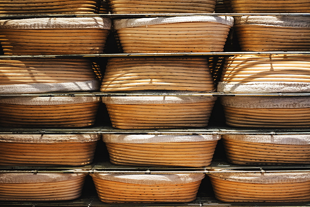 Artisan bakery making special sourdough bread, proving baskets on racks