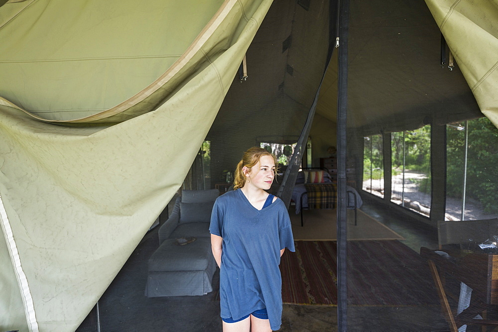 Portrait of Thirteen year old girl outside tented camp, Maun, Botswana