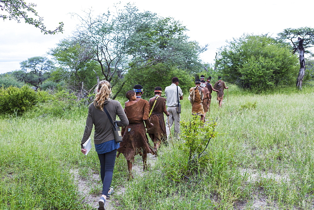 Tourists on a walking trail with members of the San people, bushmen