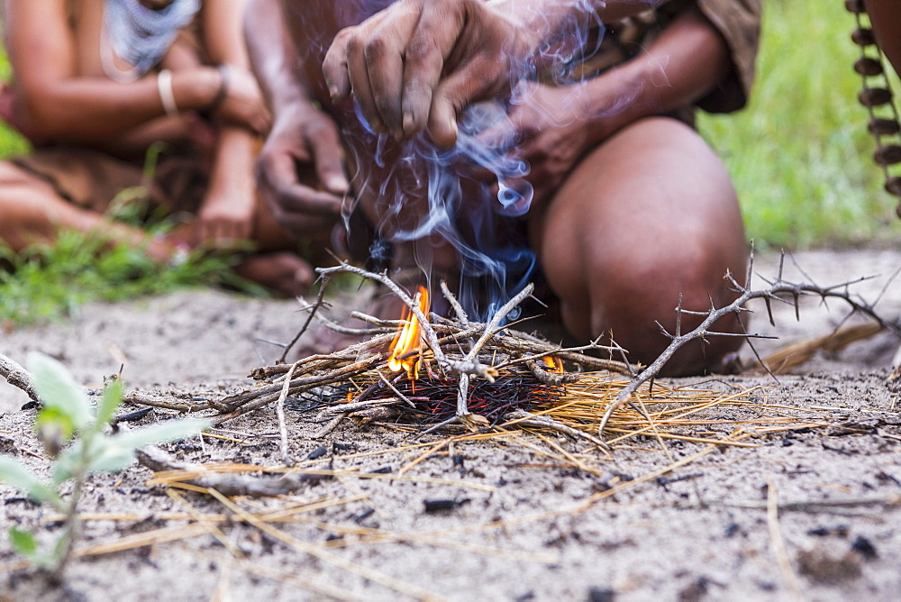 close up of Bushman creating fire, Botswana