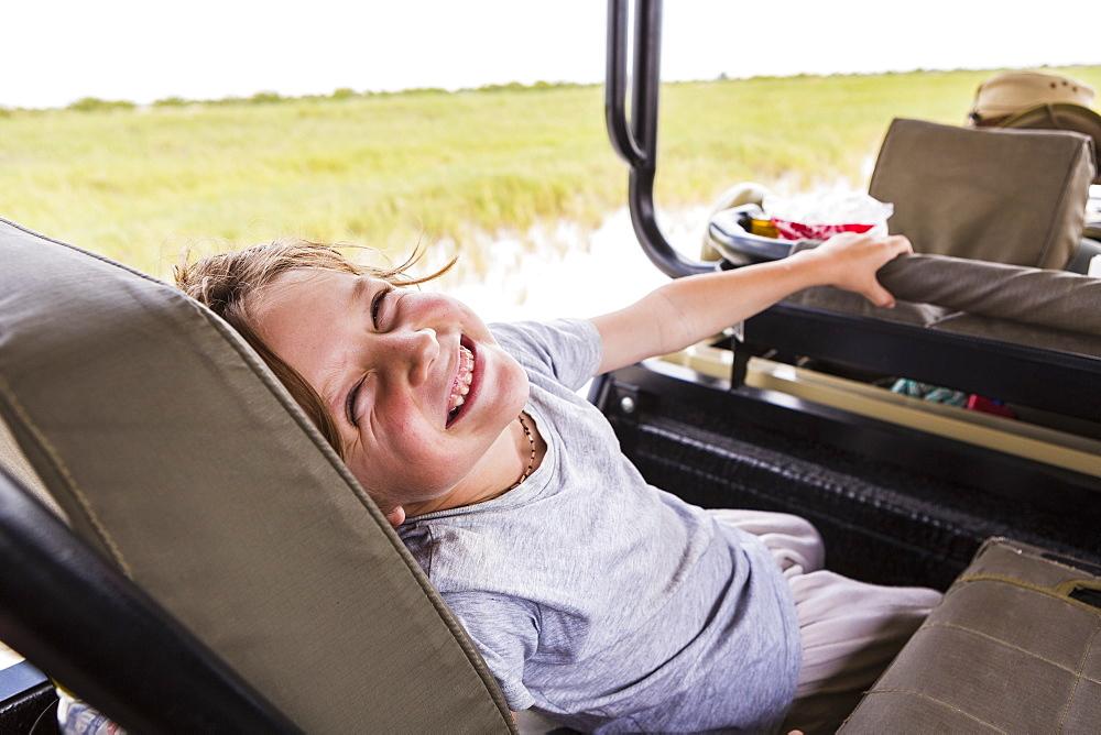 Six year old boy in safari vehicle, Botswana
