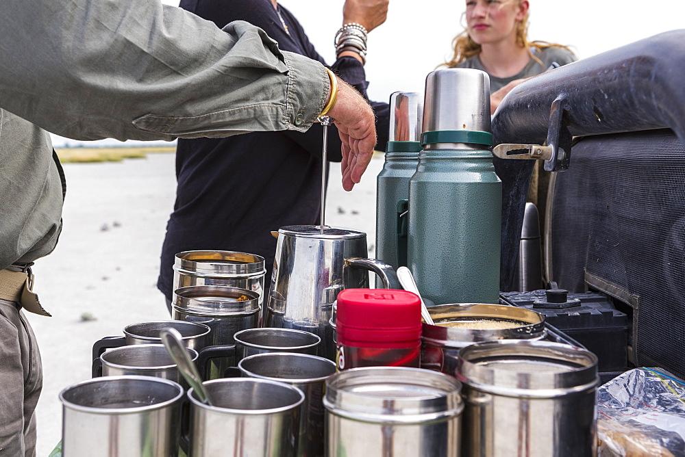 close up of metal coffee cups on safari vehicle, Botswana
