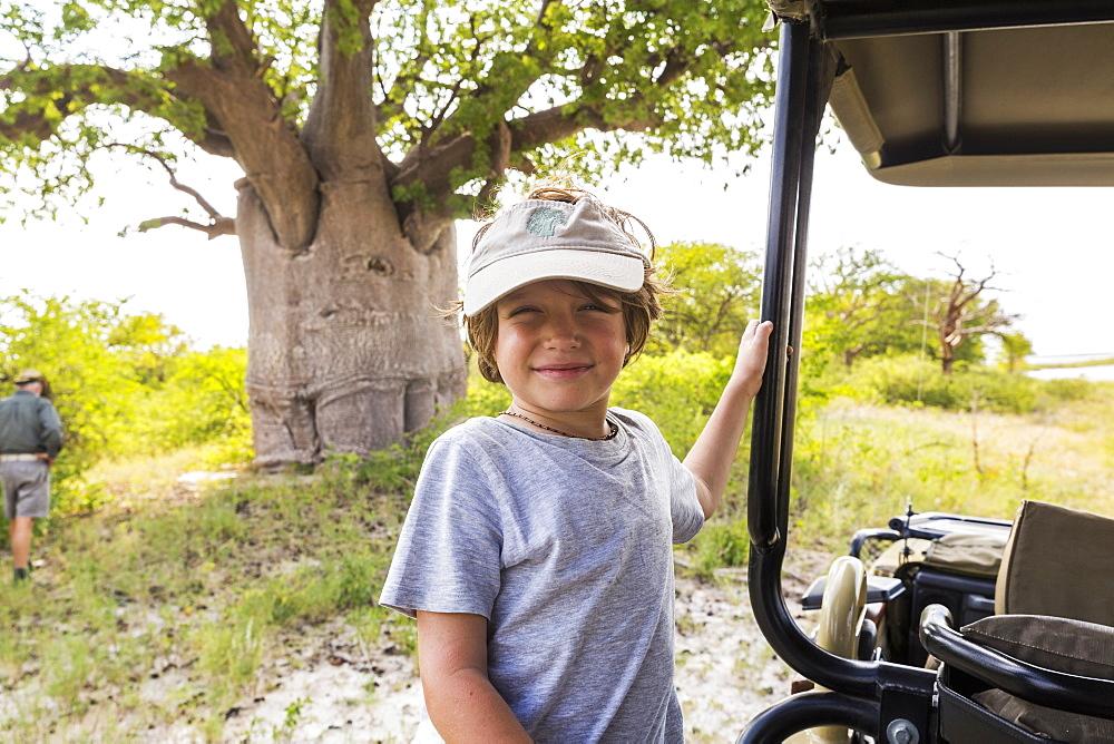 smiling Six year old boy, Baines Baobab, Botswana