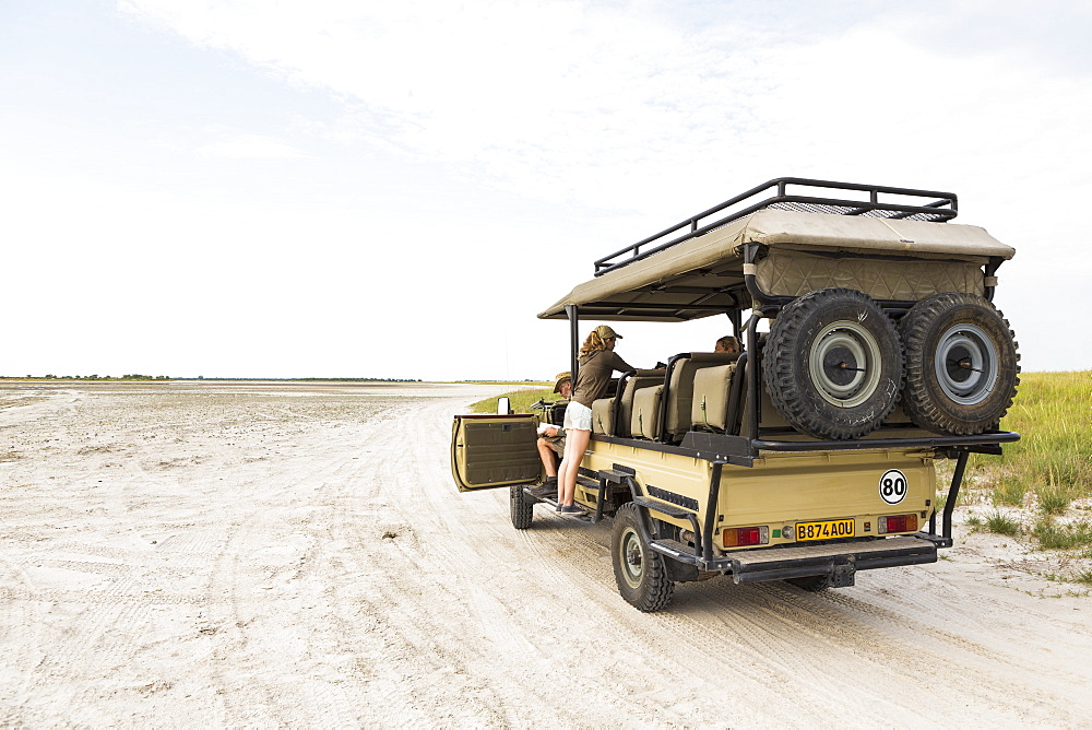 Thirteen year old leaning on safari vehicle, Botswana