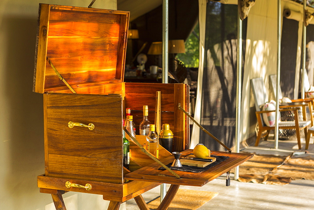 wooden liquor cabinet, at a safari camp, Maun, Botswana