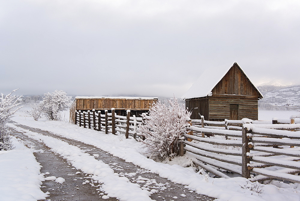 A barn and paddock with fencing in the snow in the Green River Lakes area, Green River Lakes, Wyoming, USA