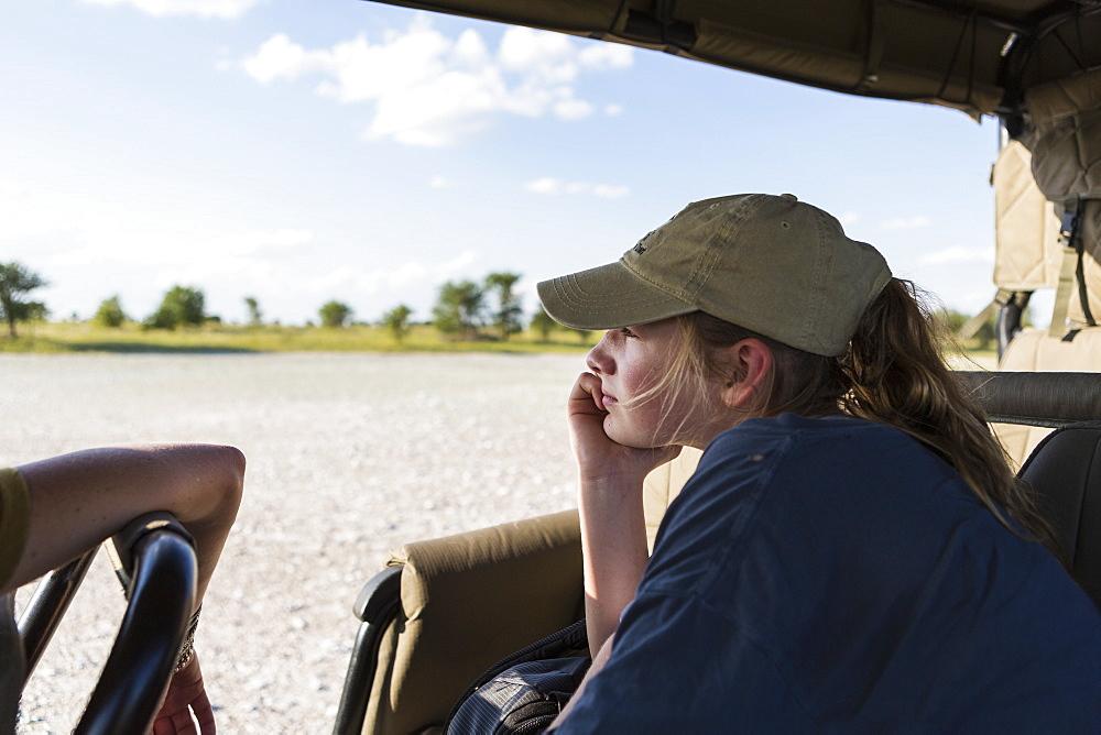 A teenage girl in a safari vehicle