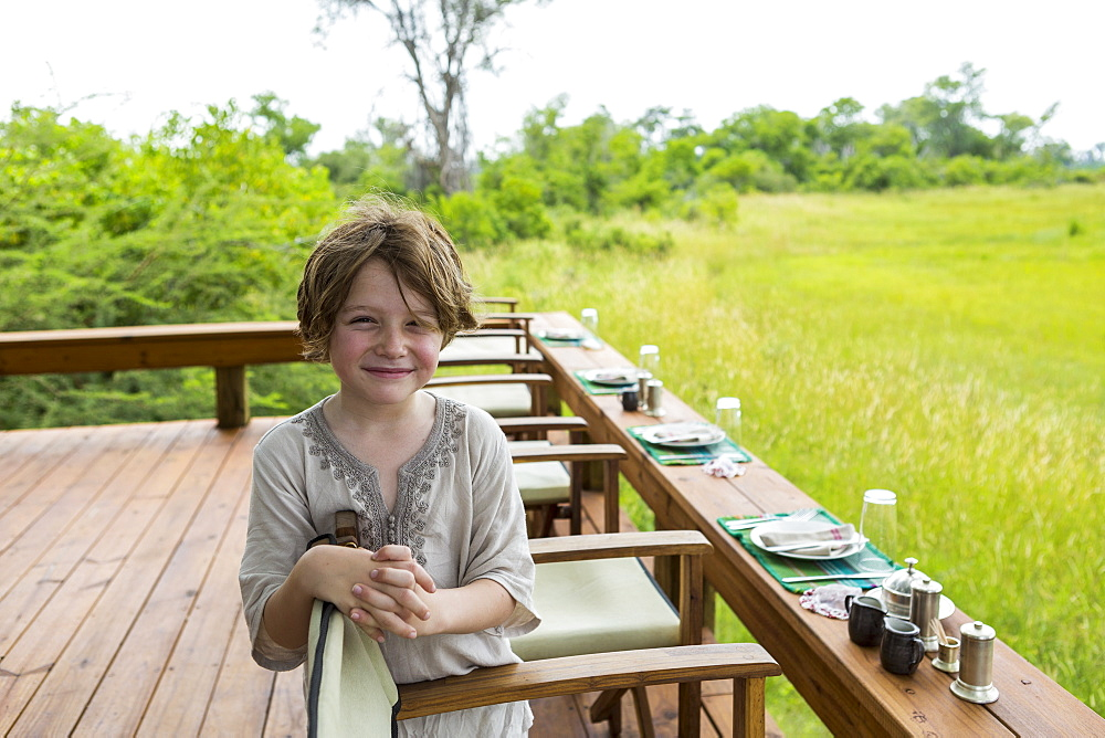 Six year old boy overlooking a scenic landscape, Botswana