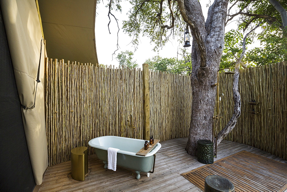 A outdoor bath tub in a tented safari camp, Botswana