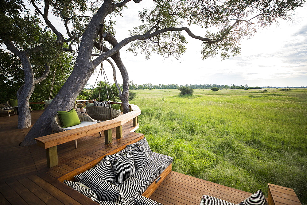 Wooden platform overlooking scenic landscape at a tented safari camp, Botswana