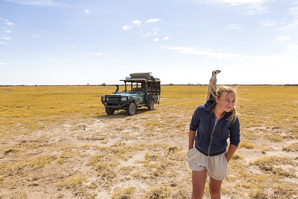 12 year old girl with Meerkat on her head, Kalahari Desert