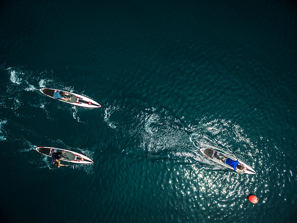 Aerial shot of a group of people on paddleboards