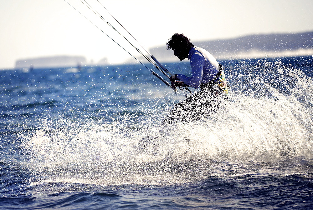 Side view of man kitesurfing on the ocean