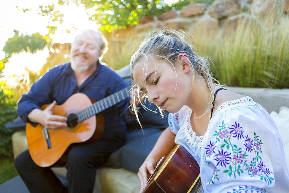 11 year old girl playing guitar - 1174-8975