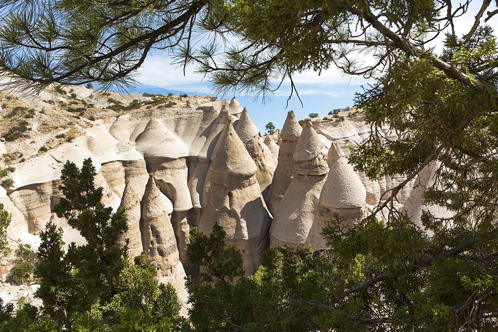 Slot canyon at Kasha Katuwe and view across to the Tent Rocks and rows of eroded rock pillars