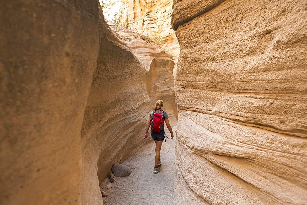 12 year old girl hiking in beautiful slot canyon Kasha Katuwe Tent Rocks, New Mexico