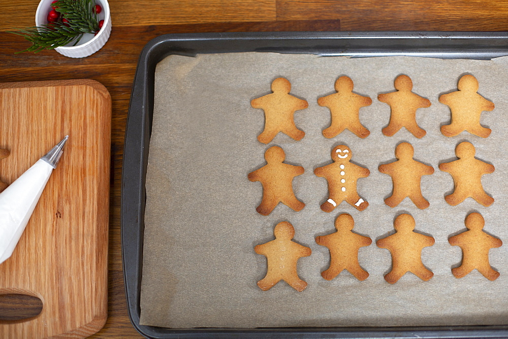 High angle close up of Gingerbread Men on a baking tray - 1174-9252