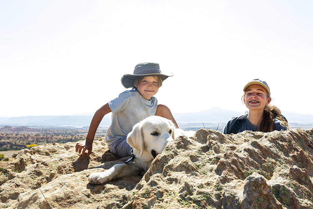 young boy and his teen sister with their dog, New Mexico, United States of America - 1174-9328