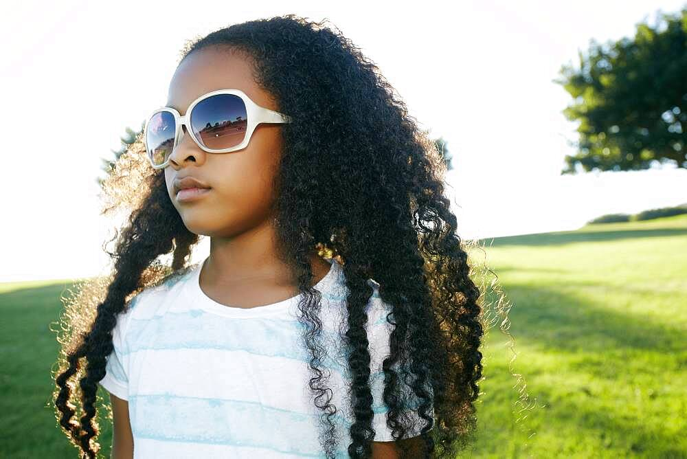 Young mixed race girl wearing sunglasses - 1174-9960