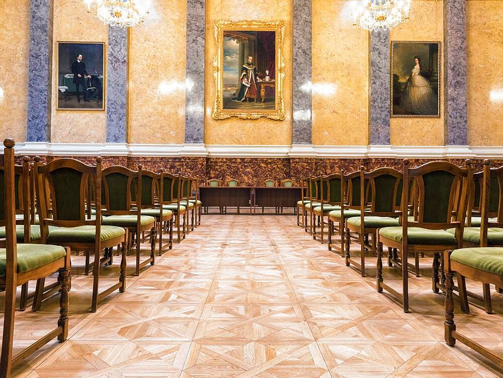 A large room with rows of chairs and chandeliers, part of the Museum of Fine Arts in Budapest - 1174-9982