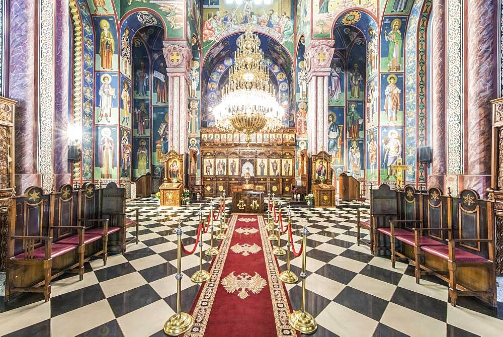 Serbian Orthodox church interior in Ljublijana, murals, painted pillars and walls, and chandelier. - 1174-9987