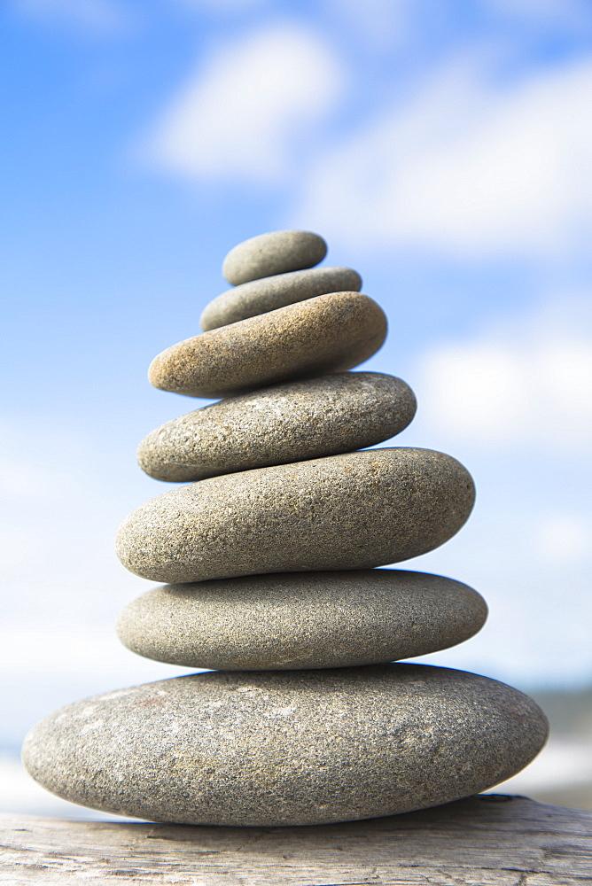 A pile of balancing smooth beach rocks near Rialto Beach, Olympic national park, in Washington, USA, Rialto Beach, Olympic National Park, Washington, USA.