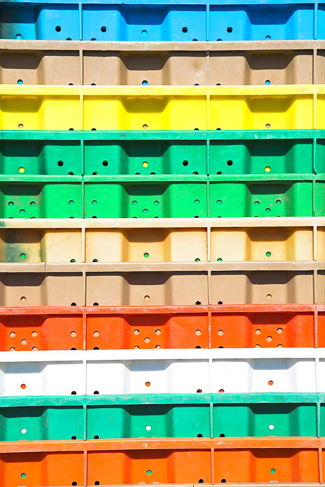 Stacks of multi-colored containers used for harvesting grapes, Washington State, USA
