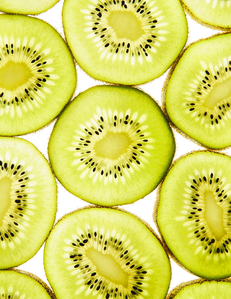 Organic kiwi slices, white background, Washington, USA