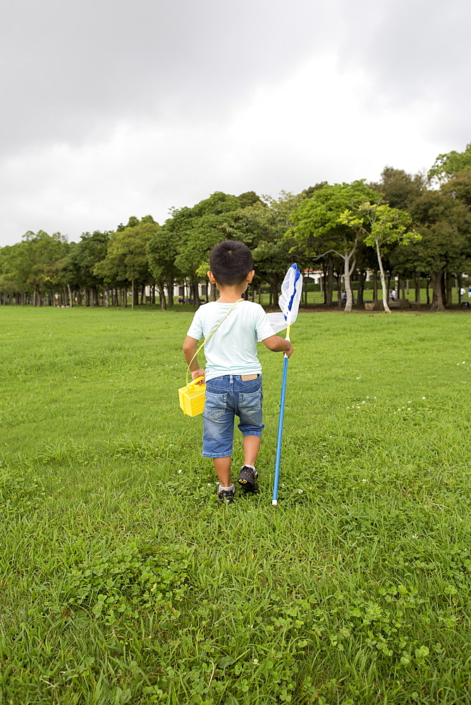 Young boy carrying a butterfly net, Kyoto, Honshu Island, Japan