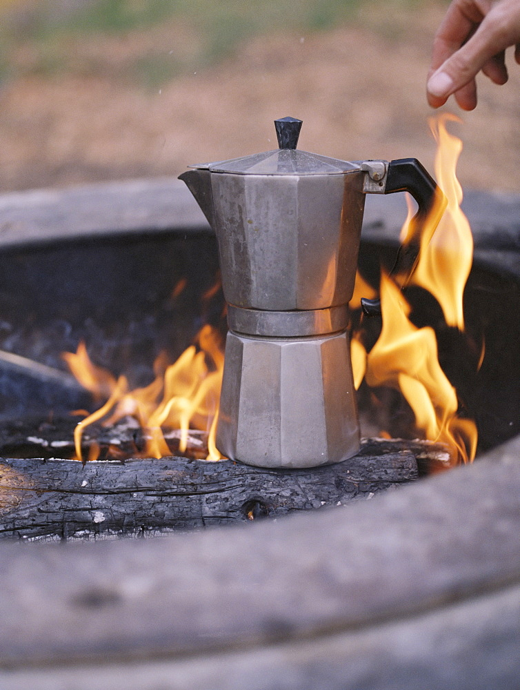 Espresso maker standing over an outdoor fire, Millcreek, Utah, United States of America