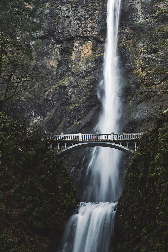 Footbridge across a waterfall. Multnomah Falls in Oregon, USA.