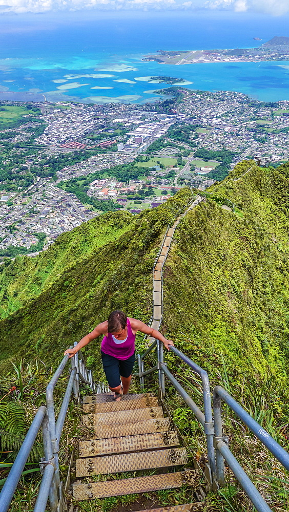 Woman on the Stairway to Heaven, Oahu, Hawaii, USA.