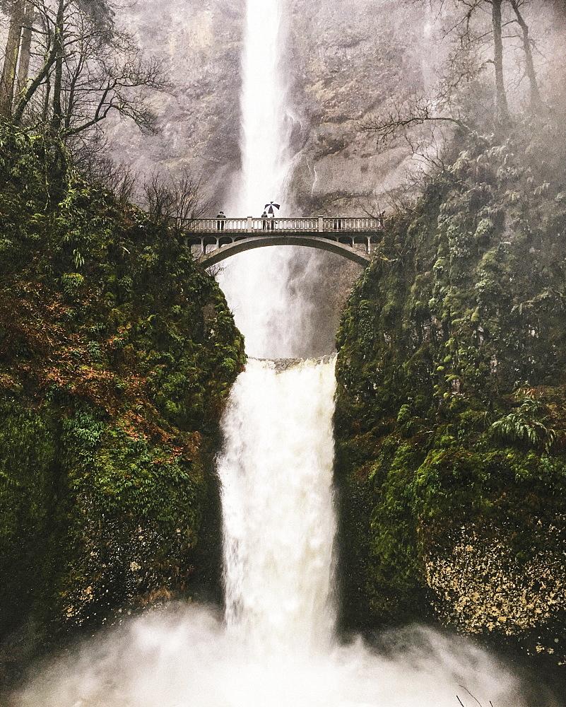 Footbridge across a waterfall at Multnomah Falls in Oregon, USA.