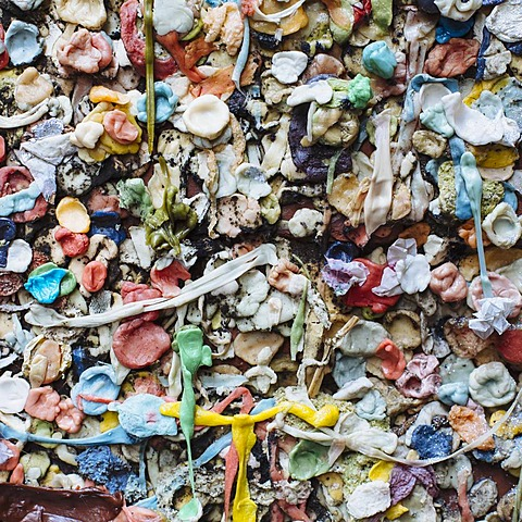 Close up of chewed bubble gum stuck on The Gum Wall in Pike Place market in Seattle.